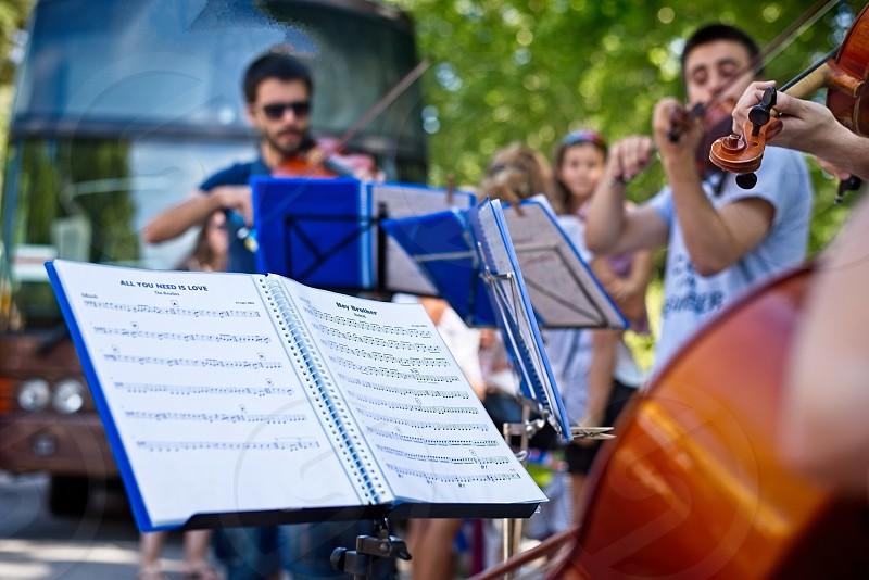 Street music violin music sheet concert art urban city young people leisure feeling  photo