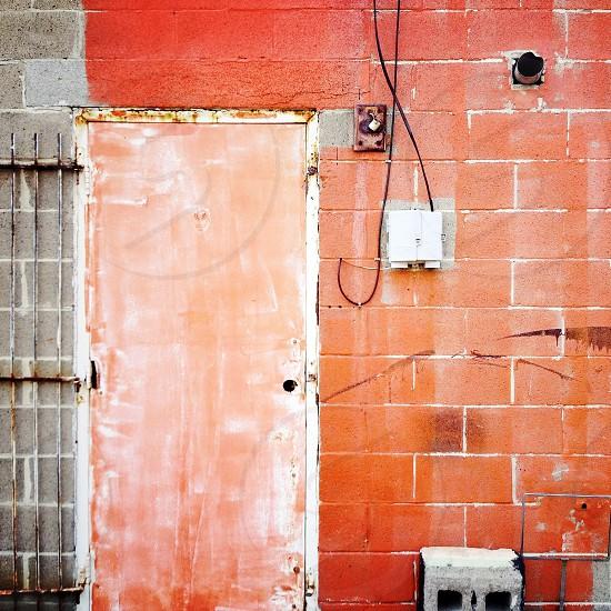 orange urban texture concrete block brick paint wires door photo