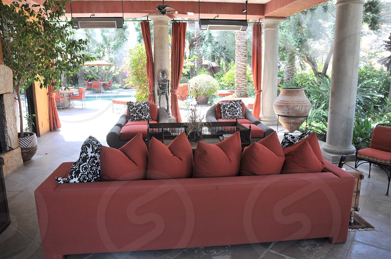 red throw pillows on red couch photo