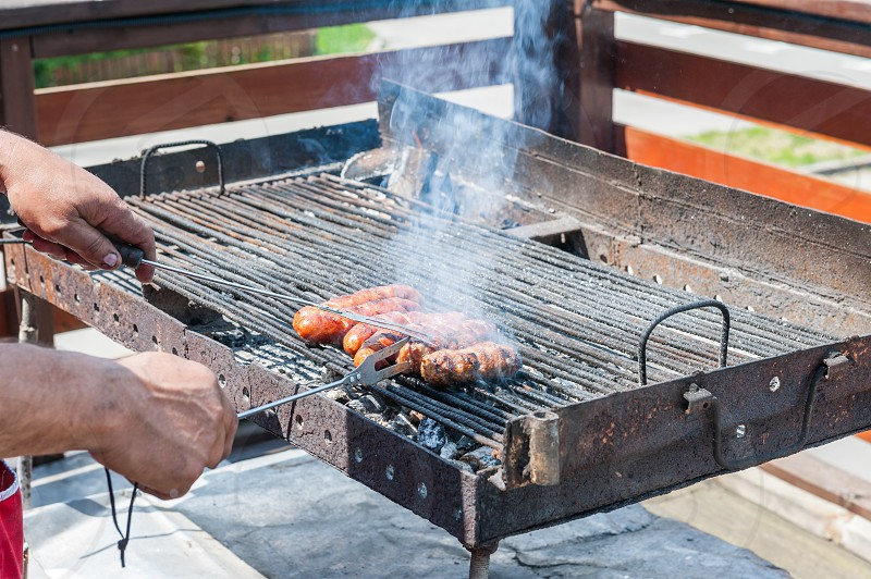 Sausages on fire photo