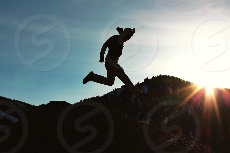 man silhouette jumping  photo