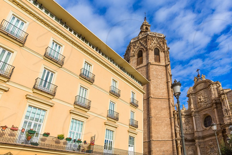 Valencia cathedral and Miguelete in plaza de la Reina square Spain photo