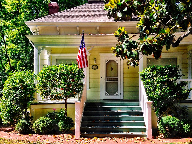 House with American flag and trees photo