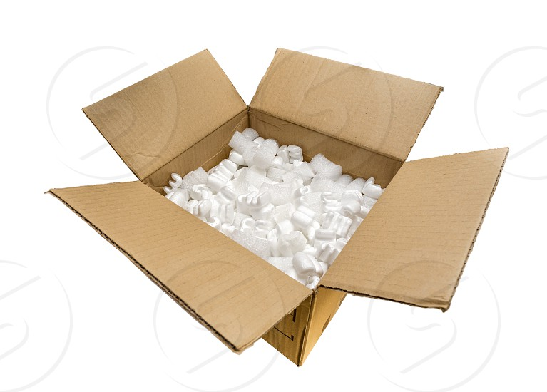 Fill packaging peanuts and bubble pack in a cardboard box isolated on white background photo