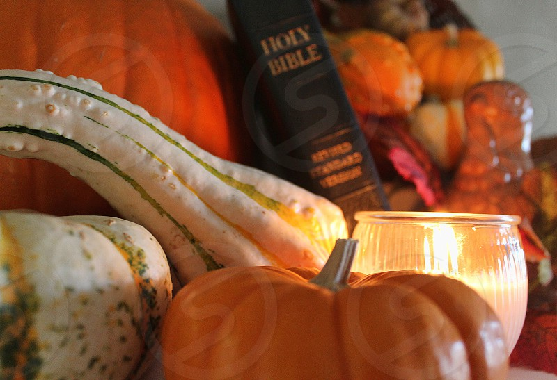 Close up of a Thanksgiving still life with a Holy Bible and candle. photo