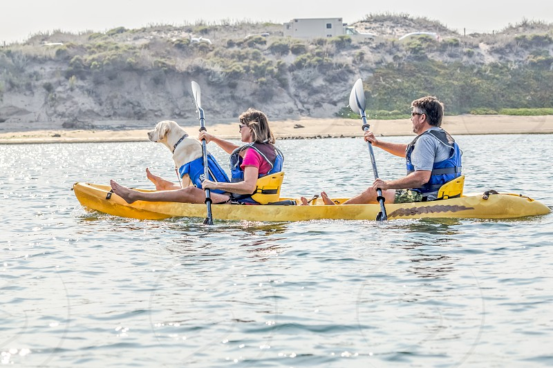 Couple with dog kayaking photo