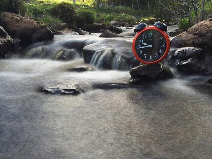 red rim round alarm clock photo