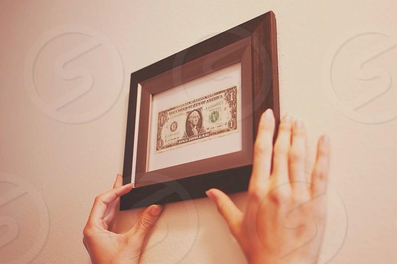 brown framed 1 us dollar bill photo
