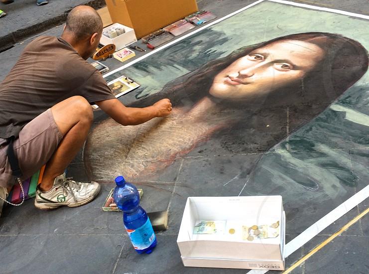 man painting mona lisa photo