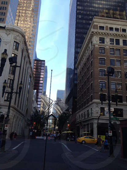 Downtown town buildings concrete people cars busy sky summer bright spring  photo