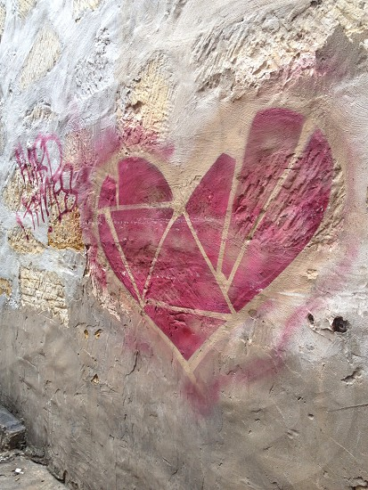 red heart paint on wall photo