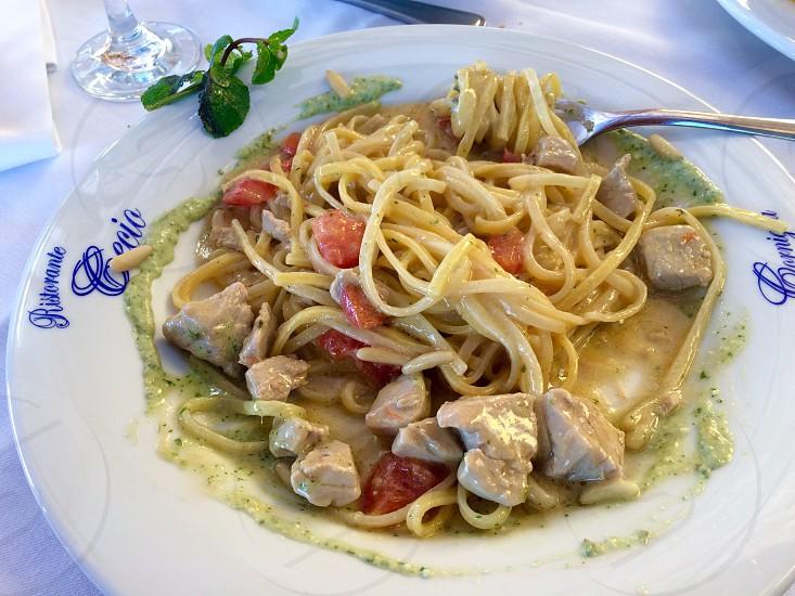 pasta dish on white ceramic plate photo