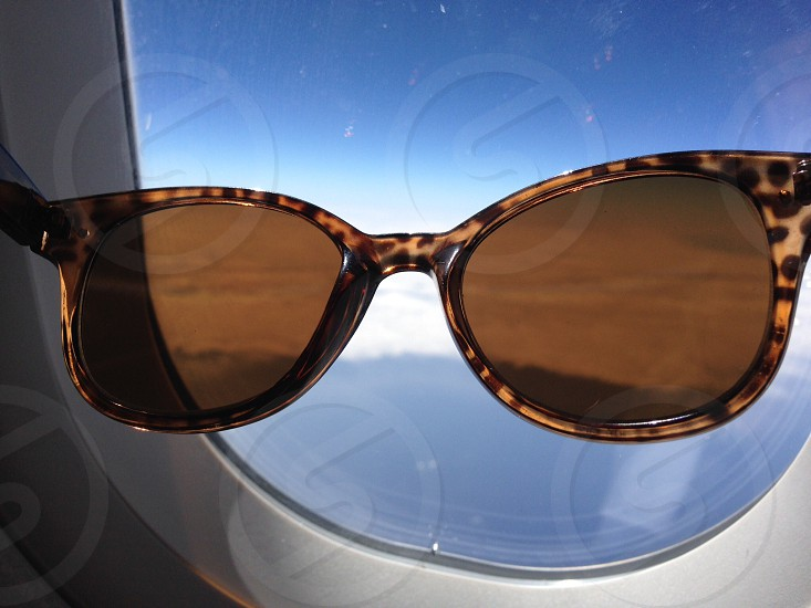 brown and black framed sunglasses photo