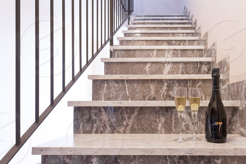 bottle of champagne on a marble staircase photo