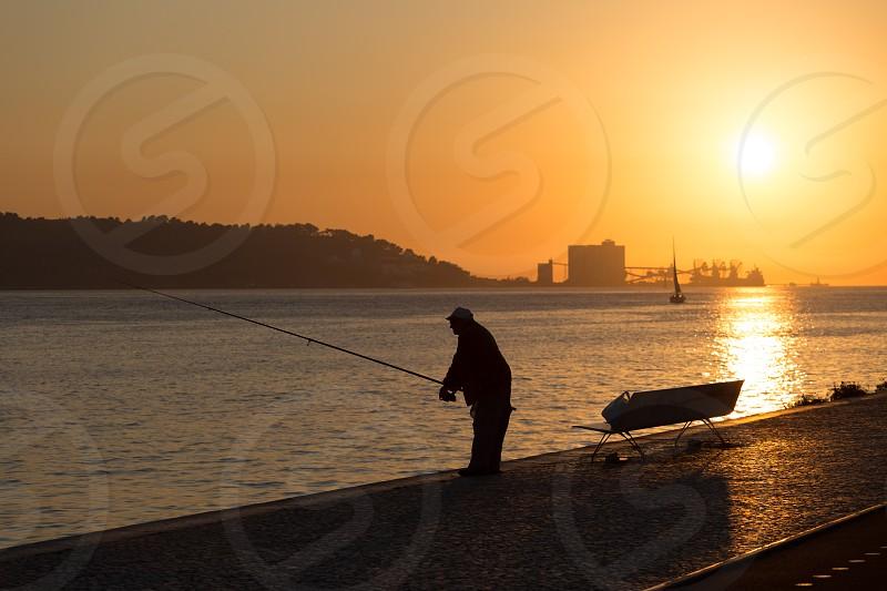 Fisherman in Lisbon photo