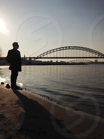 man and bridge silhouette photo