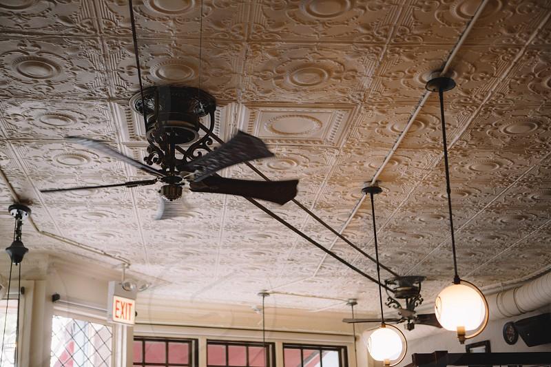 black ceiling fan turned off near lighted drop lights photo