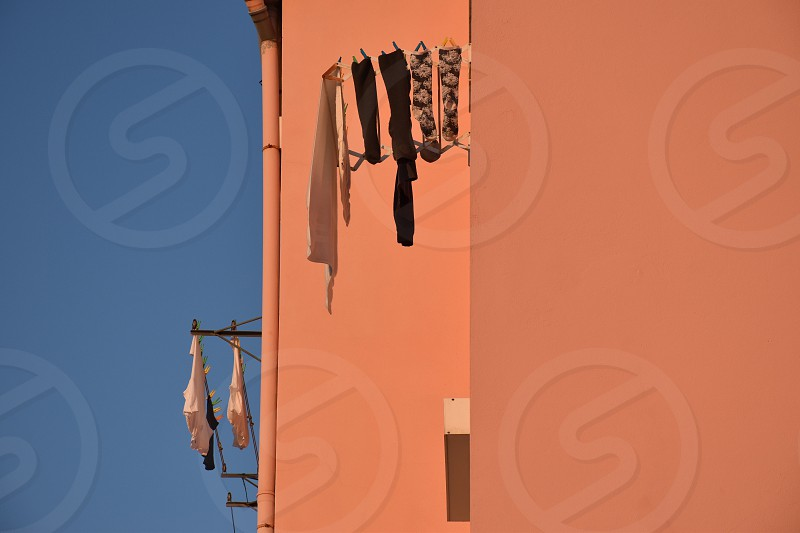 Clothes hanging in front of the wall photo