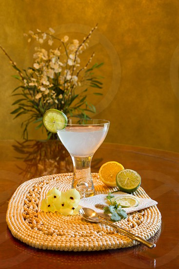 Refreshing cocktail with lime lemon flowers photo