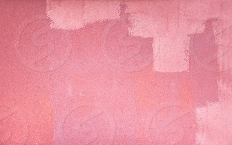 grunge brush painted pink cement wall background photo