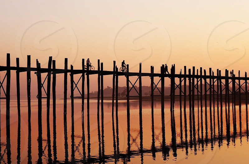 bicycle riders on a wooden dock photo