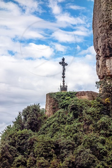 Barcelona Montserrat. Spain. Mountains from afar visible place mounted cross. photo