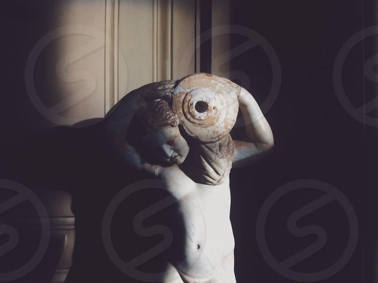 female holding jar figure stoned statue photo