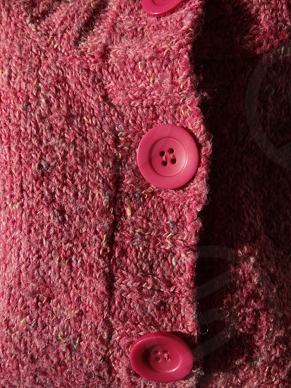 Pink wool and button photo
