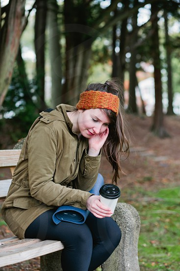 Girl young girl woman young woman youth youthful workout post workout coffee coffee cup warm cold january fall autumn october cute pretty outgoing fitness yoga yoga mat quirky outgoing park park bench bench portrait looking away photo
