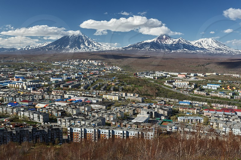 Panoramic view of the city Petropavlovsk-Kamchatsky and volcanoes: Koryaksky Volcano Avacha Volcano Kozelsky Volcano. Far East Russia Kamchatka Peninsula. photo