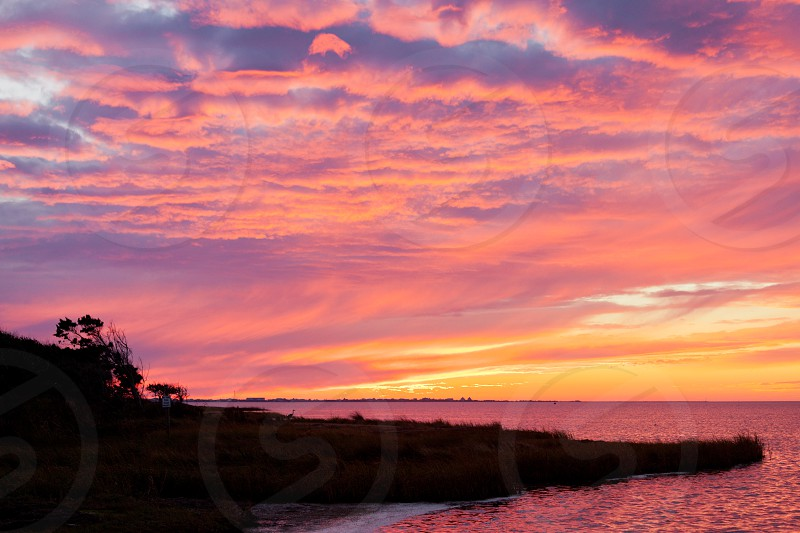 Sunset over calm water of Pamlico Sound off Hatteras Island Outer Banks OBX North Carolina NC US photo