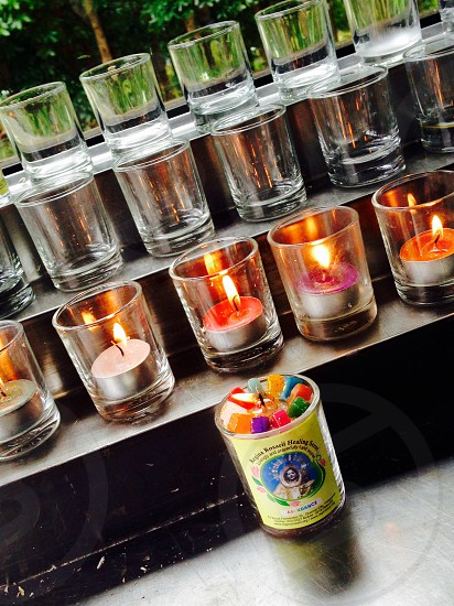 Colorful lighter candles for prayers photo