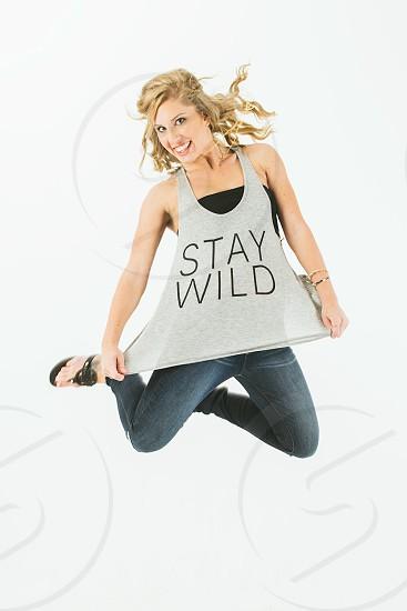 Comfort statement t shirt shirt graphic tee graphic shirt jump fun model stay wild blonde girl  photo