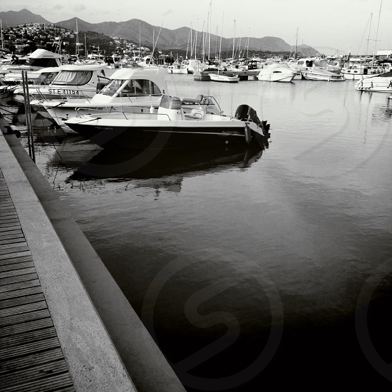 black and white speed boat on dock photo