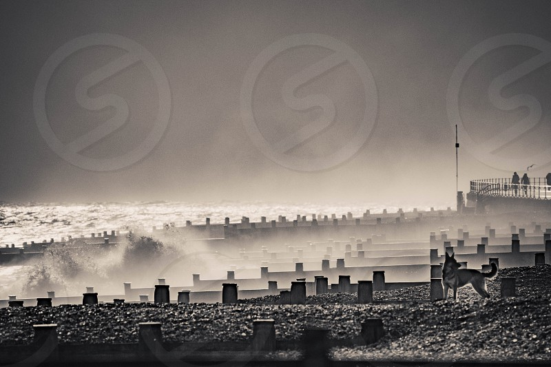 EASTBOURNE EAST SUSSEX/UK - JANUARY 7 : Stormy Weather at Eastbourne Seafront in East Sussex on January 7 2018. Unidentified people photo