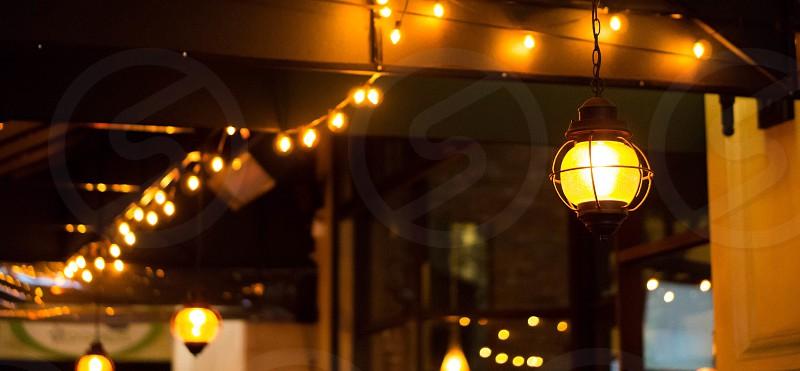 Outdoor patio light hanging lights night city decor  photo