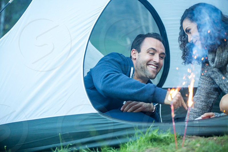 First Anniversary Couple Celebrating outdoors camping sparklers photo
