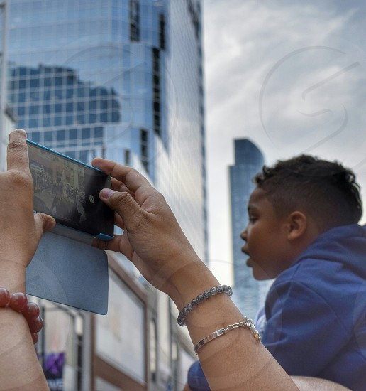 street festival boy smartphone Toronto photo
