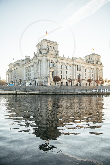 white building near the body of water during day time photo