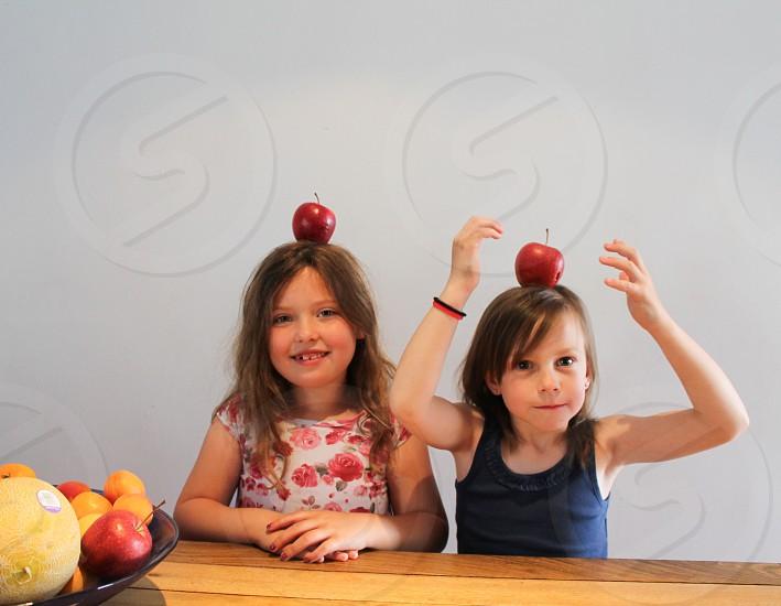 Balancing apples photo