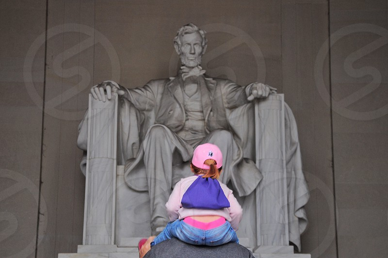 girl in front of abraham lincoln statue photo