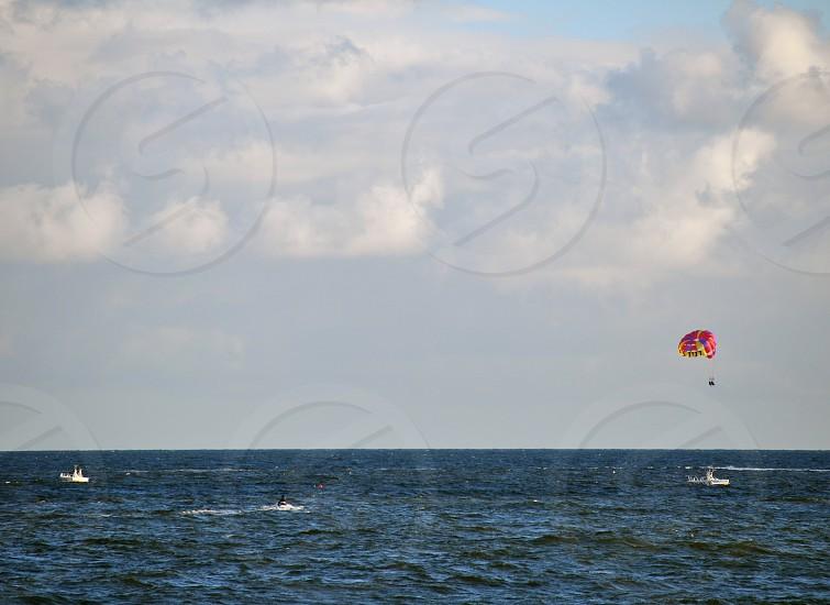 Parasailing over the Atlantic Ocean photo