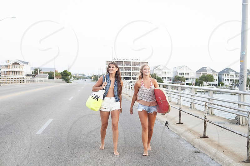 two women walking and smiling photo