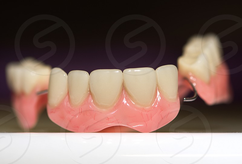 Dental prosthesis on dark background photo