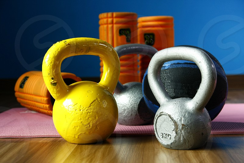 Assorted gym or exercise equipments photo