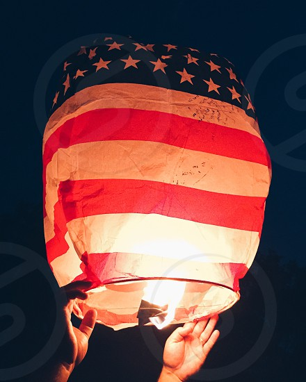 Fourth of July lantern summer holiday red white blue flag photo