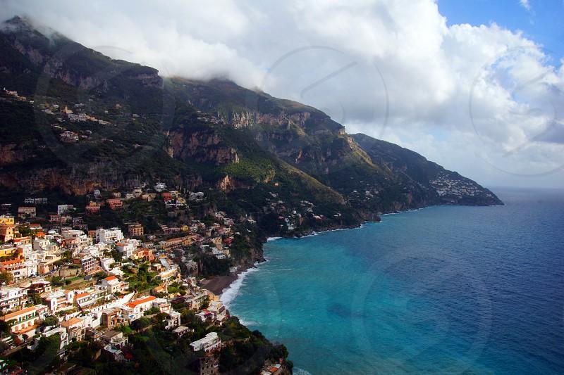 aerial view village near ocean photograph photo