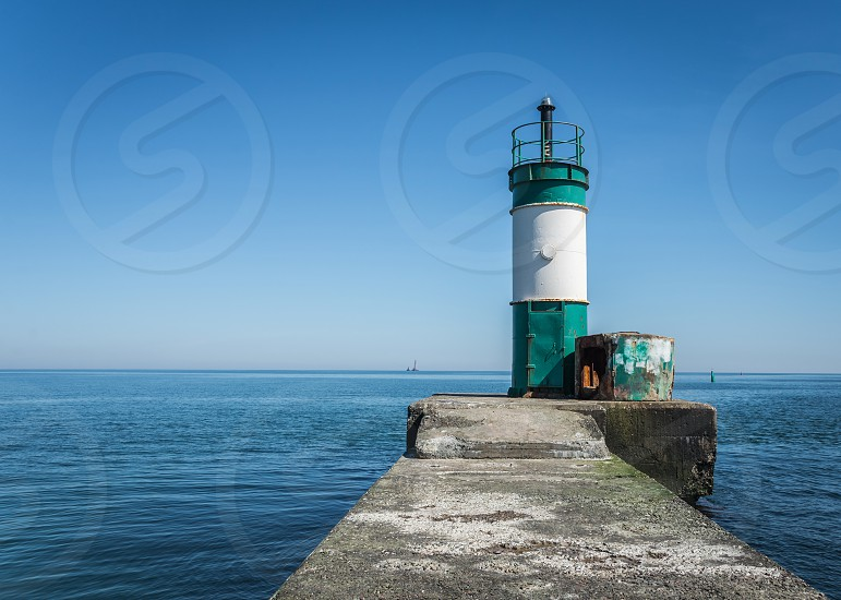Old lighthouse in the cargo port and container terminal in Odessa Ukraine photo