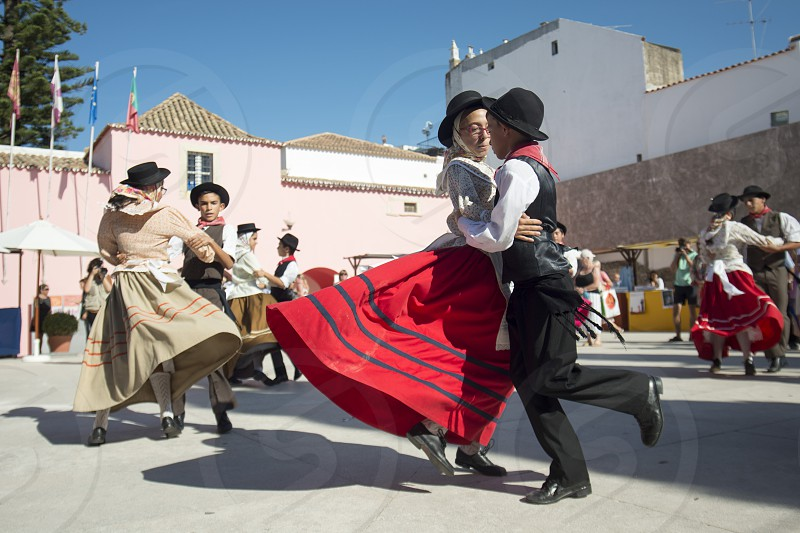 traditional portugese Dance at the Saturday Market in the town of Loule in the Algarve in the south of Portugal in Europe. photo