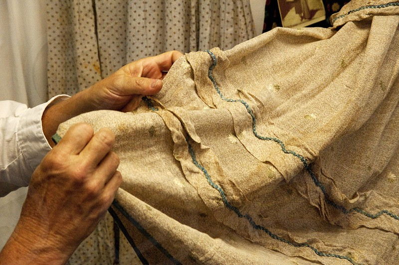 Stitching an old dress sewing hands photo